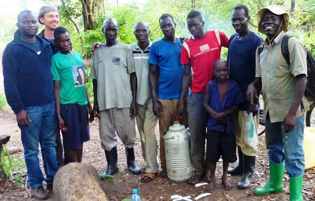 ITM and Gulu University staff with residents of Beyogoya village